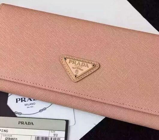 PRADA Saffiano leather flap wallet with enamel triangle logo geranio  Diese und weitere Taschen auf www.designertaschen-shops.de entdecken