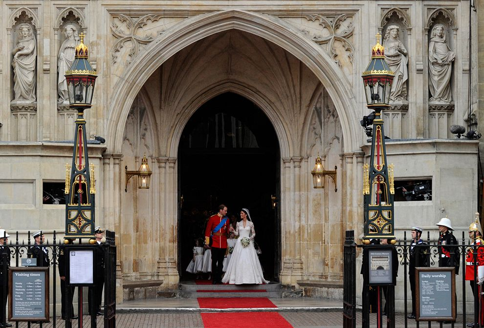 Britain\\u0027s Prince William and Kate, Duchess of Cambridge leave Westminster  Abbey following their wedding ceremony