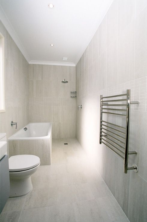 If keep door where is, then consider layout - bath shower perpendicular.  Toilet behind