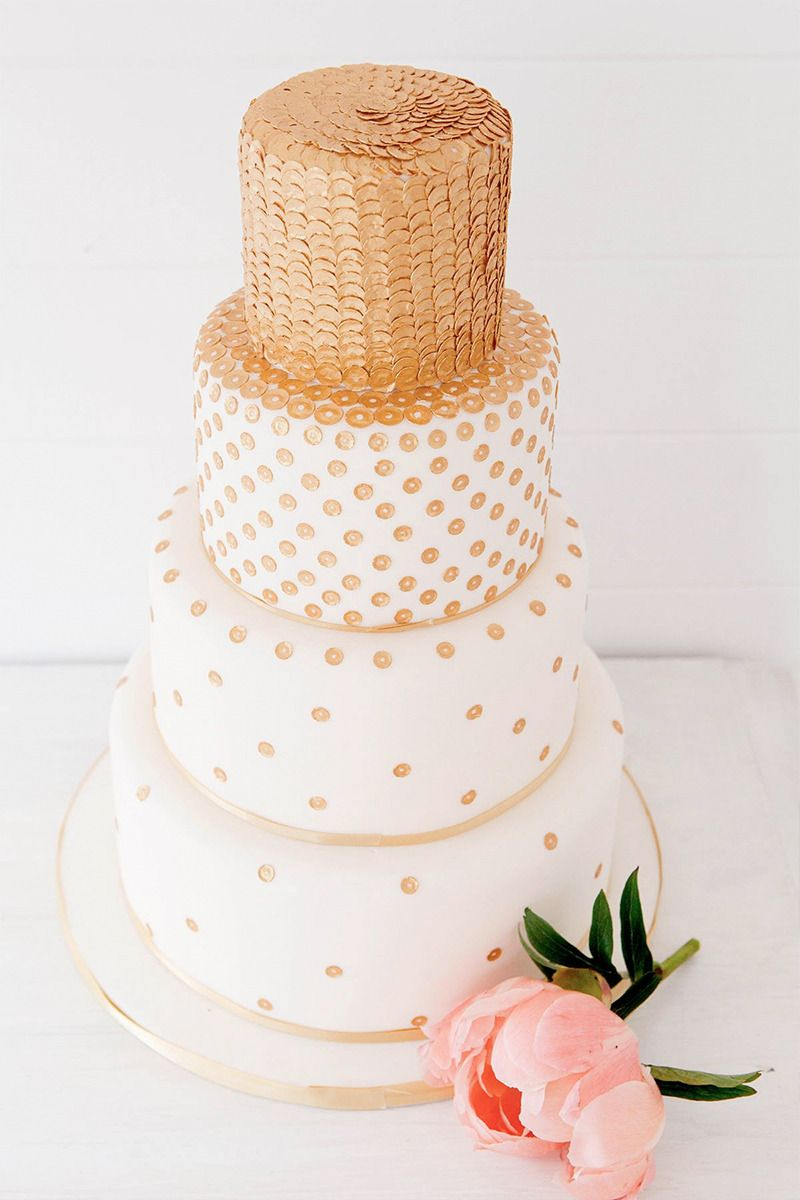 Gold cakes bring fancy to any wedding. You definitely do not need to have an entirely gold wedding to incorporate a gold cake into your wedding. CreditsPhotographers:  Corette Faux View Post Pink And Gold Bridal Session