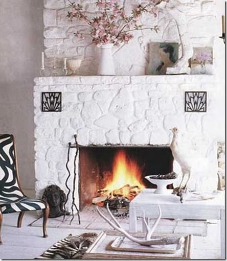 Painted white stone fireplace.                              …                                                                                                                                                                                 More