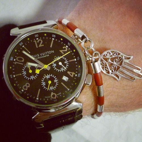 Louis Vuitton watch and a unique bracelet.