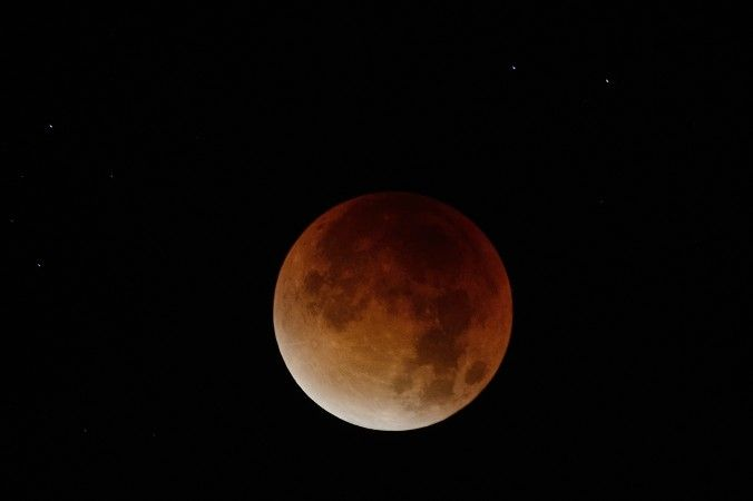 Amateur Astronomers Philosophize About Life and Death Amid Red Lunar Eclipse