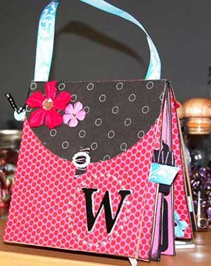 Purse paper bag album. Great tut's on the website!!  .Nice for holding stories, recipes, etc.