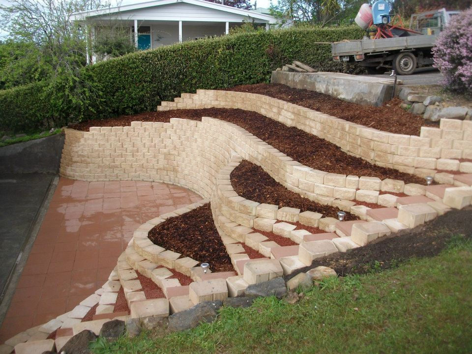 Retaining wall in front of concrete ditch google search for Garden designs on a slope