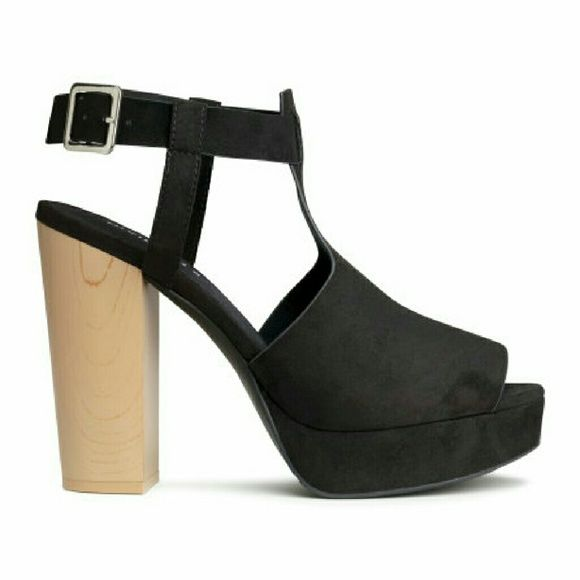 Last Chance. HP!! Platform sandals I seriously love these platform sandals in imitation suede. Adjustable ankle strap with metal buckle. Rubber soles. Front platform height 1 1/4 in., heel height 4 3/4 in. They make your feet look really nice. I would say it's a small 7 meaning it also fits 6/12 Shoes Sandals
