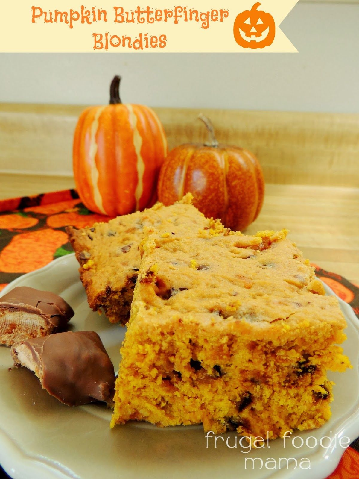 Pumpkin Butterfinger Blondies- a moist, cake-like blondie full of Butterfingers and chocolate chips
