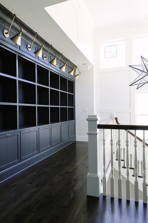 Ebony Wood Floors Beautifully Complement Dark Gray Built In Cabinets Accented With Antique Brass Hardware And F Bookshelves Built In Library Lighting New Homes