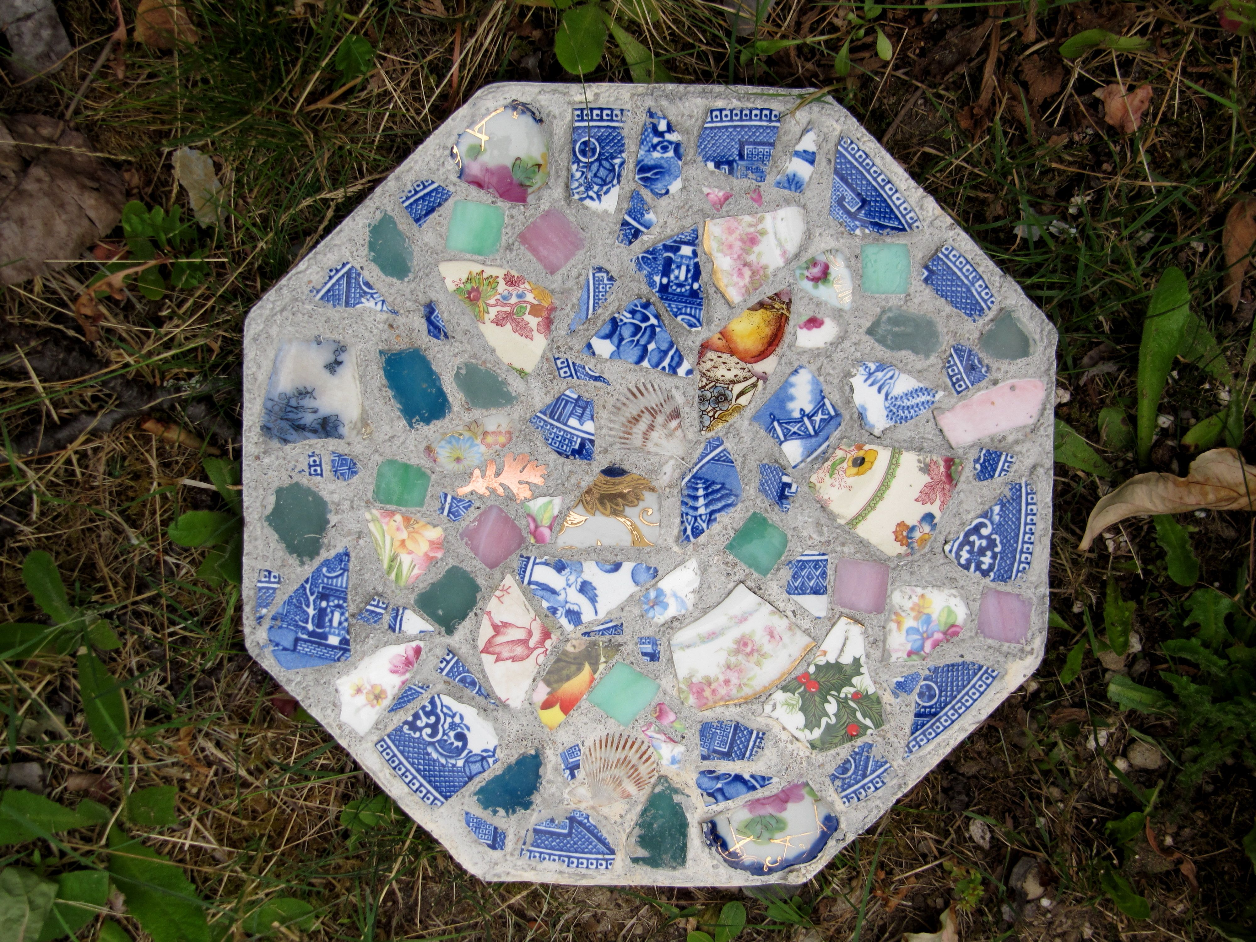 Diy Stepping Stones Stepping Stone Made Of Broken Pottery And Glass By Emily Hickman