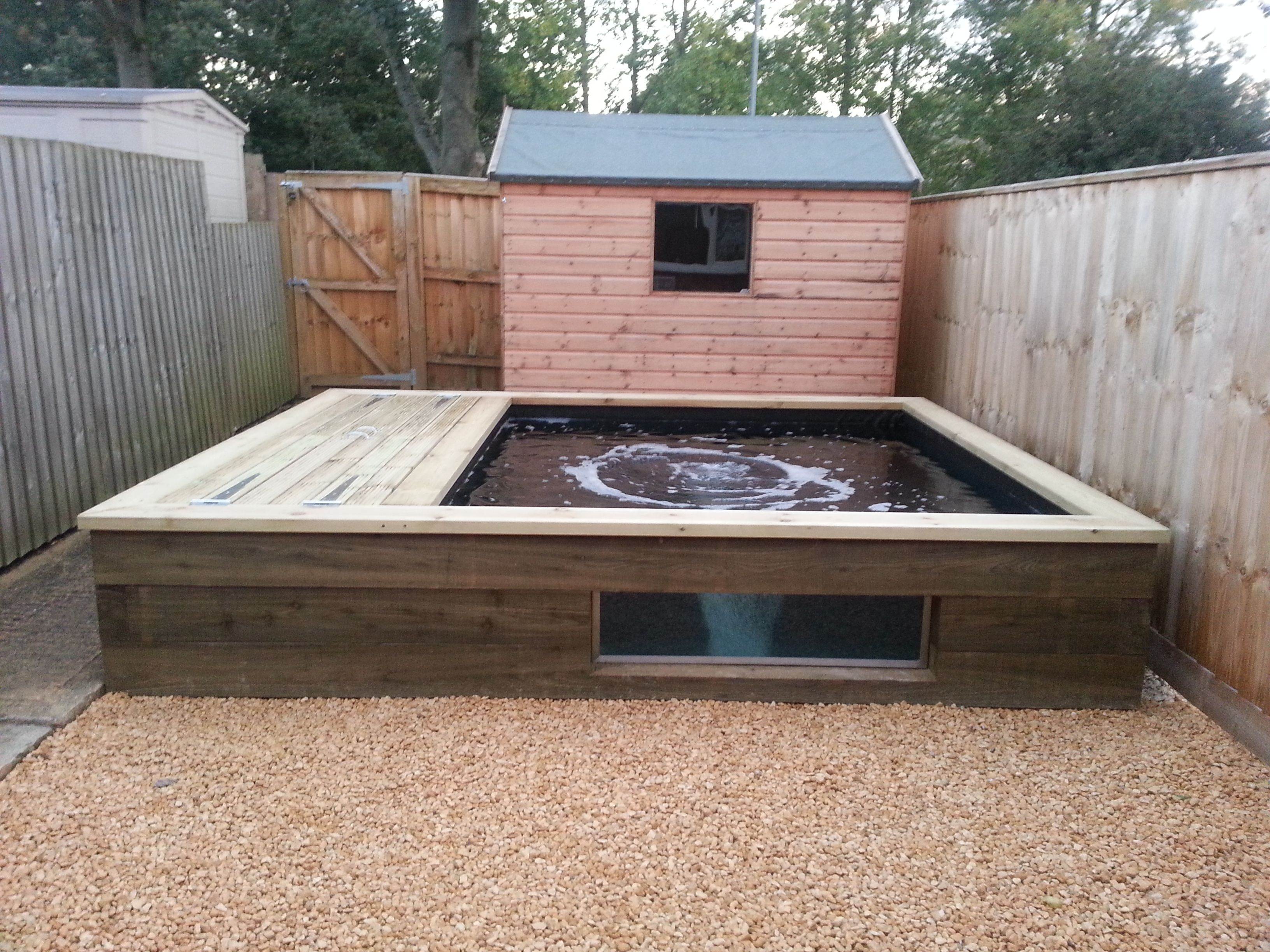 Billedresultat for how to build a raised pond havedamme for Wooden koi pool