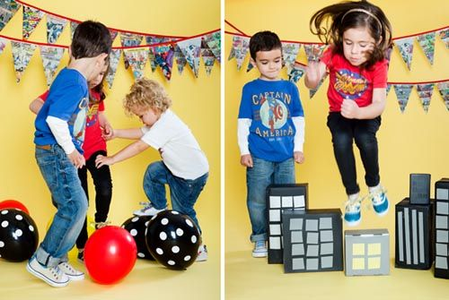 superhero games-squirting big bad guy (T.H.E. Bad Guy – my hubs), bomb diffusing (popping balloons), leaping tall buildings (paper covered diaper boxes), kryptonite handling (neon green spray painted rocks), and web slinging (silly string).