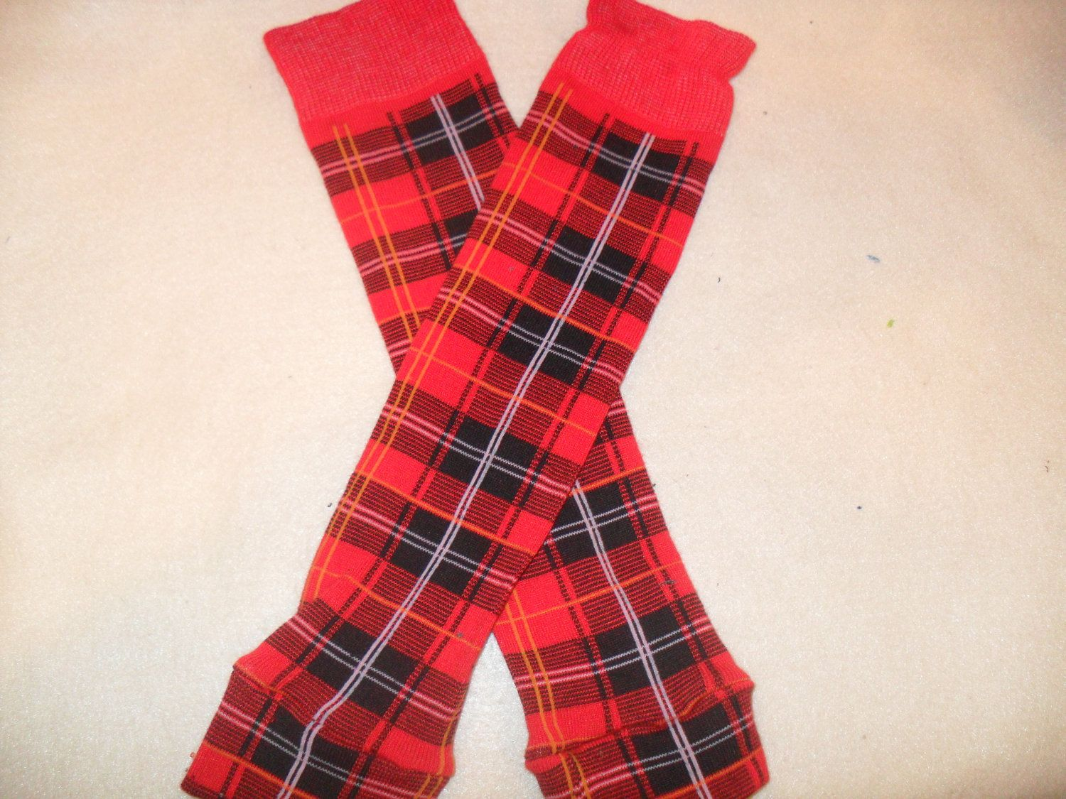 Red and black plaid crawler Covers baby leg by ImpulsiveCrafter. , via Etsy.