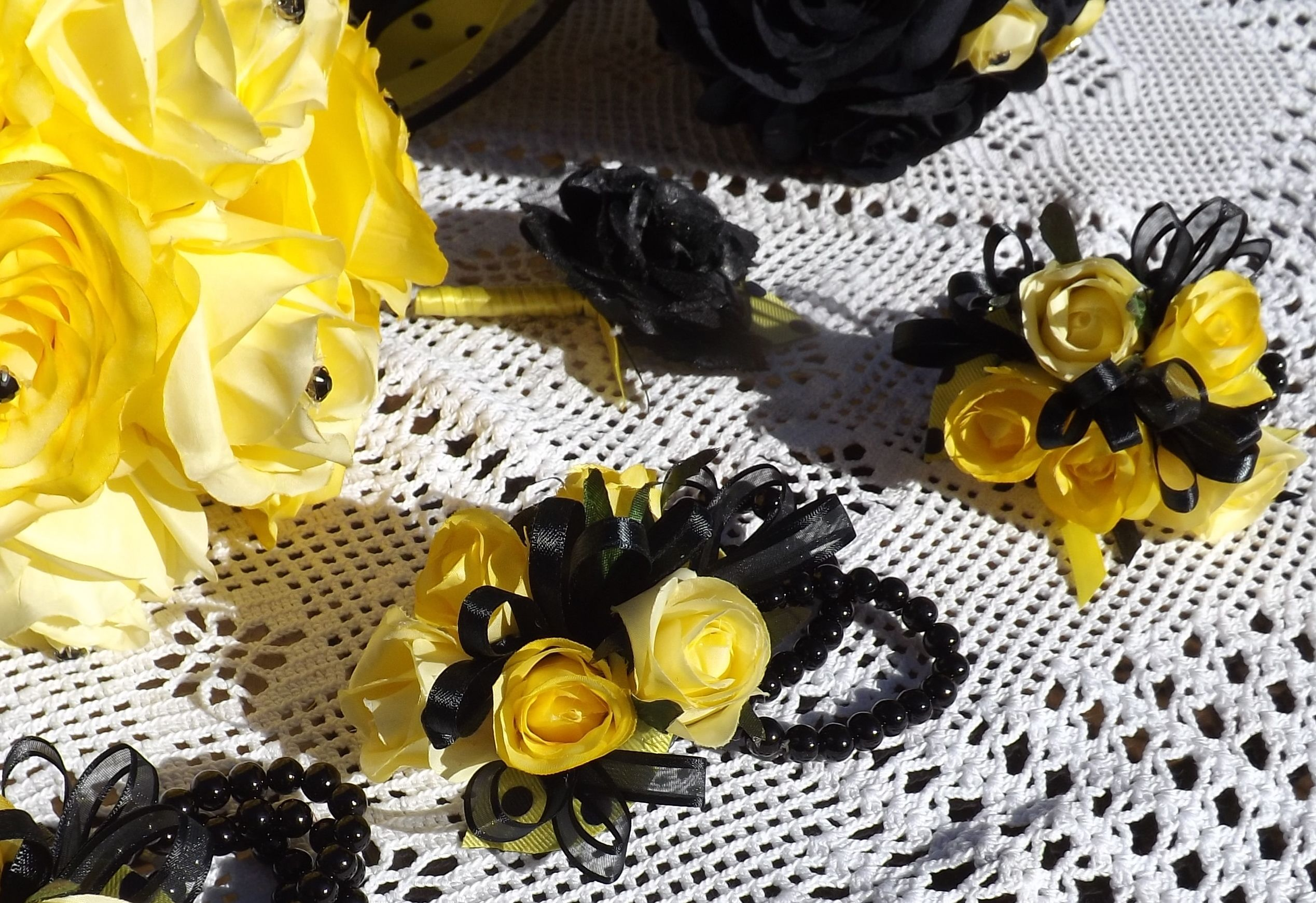 Batman Inspired Wedding Wrist Corsages Are Black And Yellow Roses