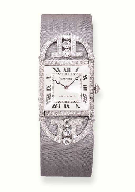 AN ELEGANT ART DECO DIAMOND WRISTWATCH, BY CARTIER With 14 jewelled lever movement, adjusted to eight positions, matte silvered guilloché dial with Roman numerals and blued steeled moon hands, rectangular case with rose-cut diamond bezel and winding crown.