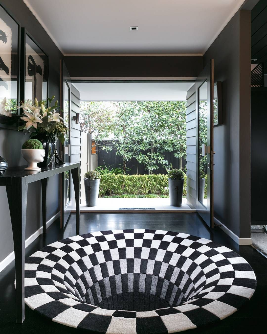 Down The Rabbit Hole Our Ever Popular Black Hole Rug By Daniel Malik Creates A Totally Unique Entrance To This Home By Seaga Cool Rugs Rug Design Perfect Rug