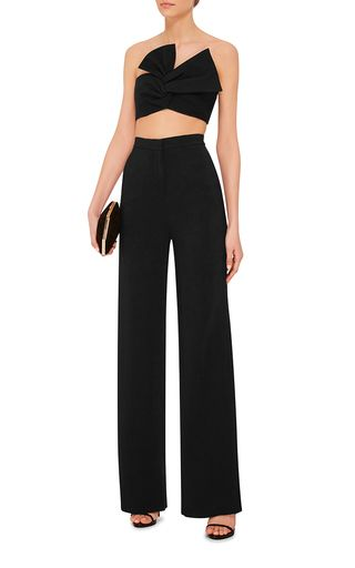 add11340f0b10 This   Cushnie et Ochs   top features a cropped silhouette with an  oversized twisted bow at the front.