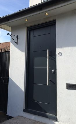 Anthracite grey modern door with long bar handle in brushed chrome ...