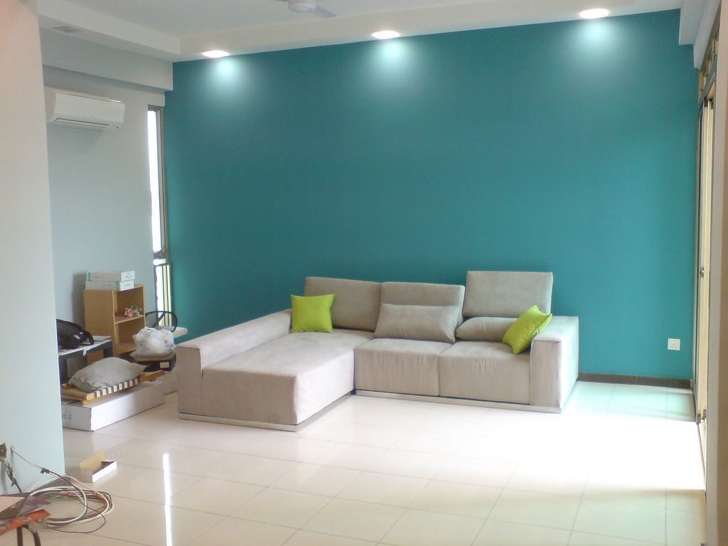 A feature wall is a great idea for your lounge What colour would