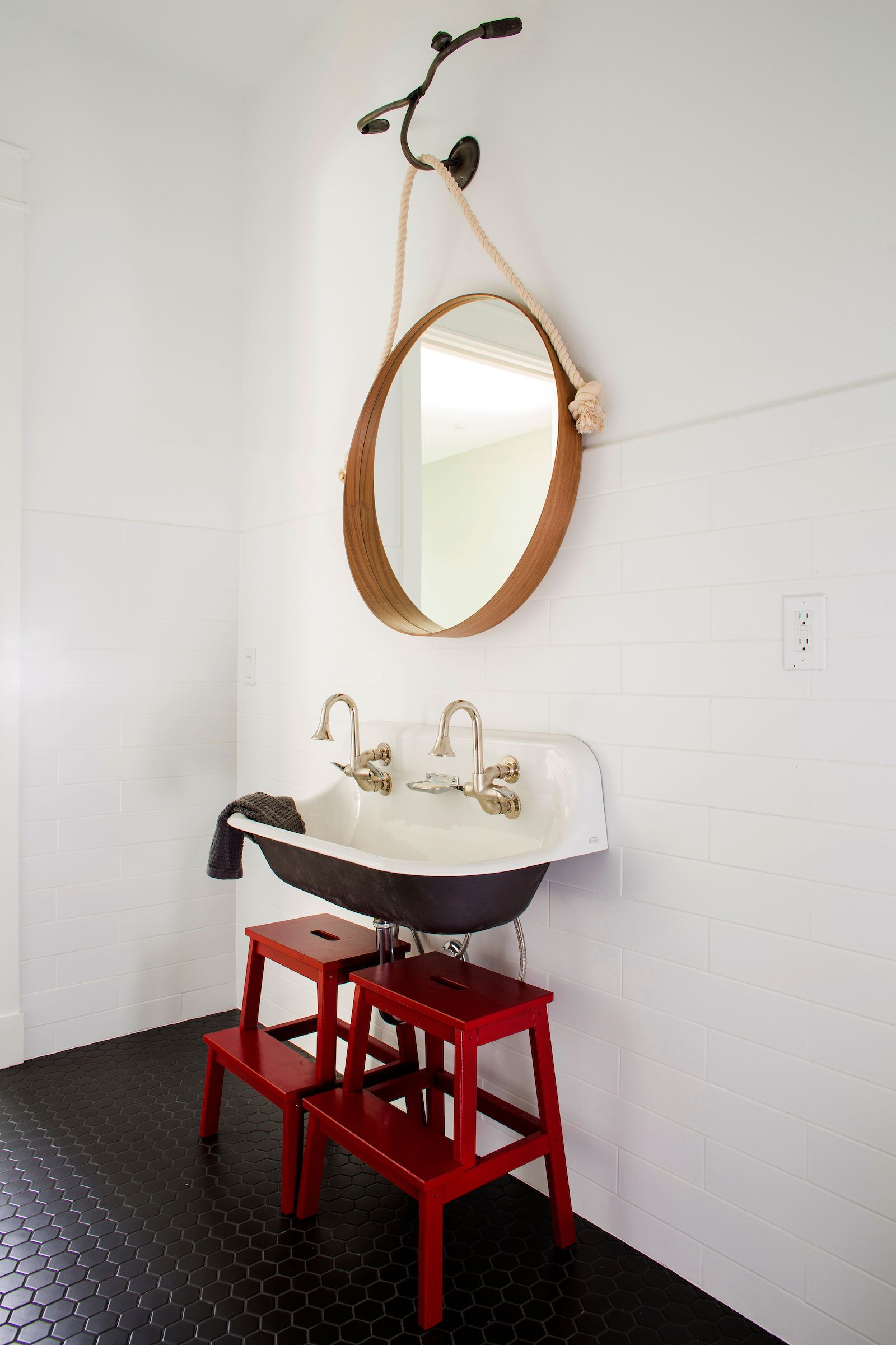 A black, white and red bathroom created with manhattan white subway ...