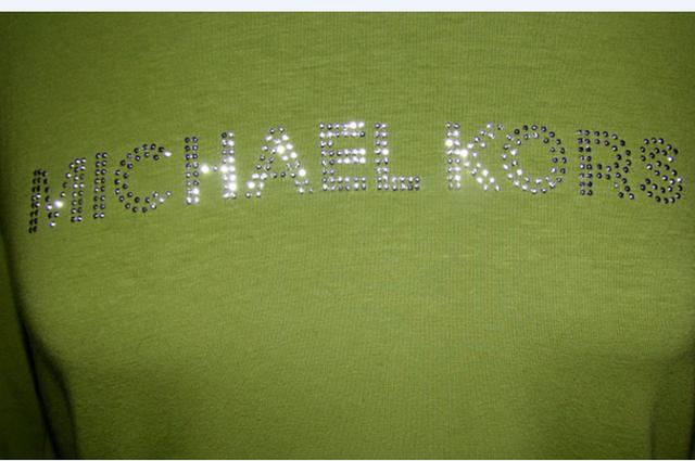 (#21) Green Michael Kors Tshirt size large. Starting at $5