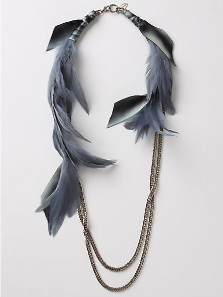 Loving the feather trend on necklaces, I like this reverse take on it, feathers at top.