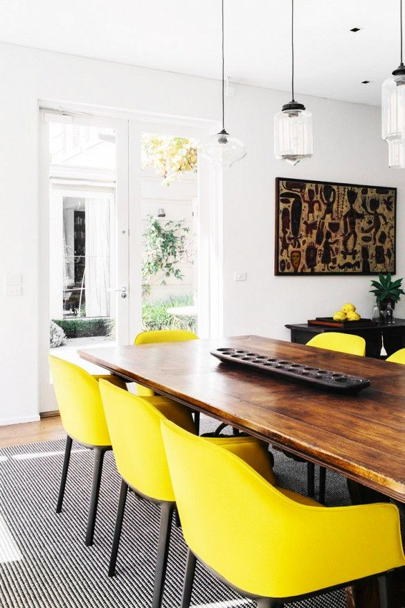 A Yellow And Black Dining E With Vibrant Chairs Eclectic Light Fixtures Cool Art