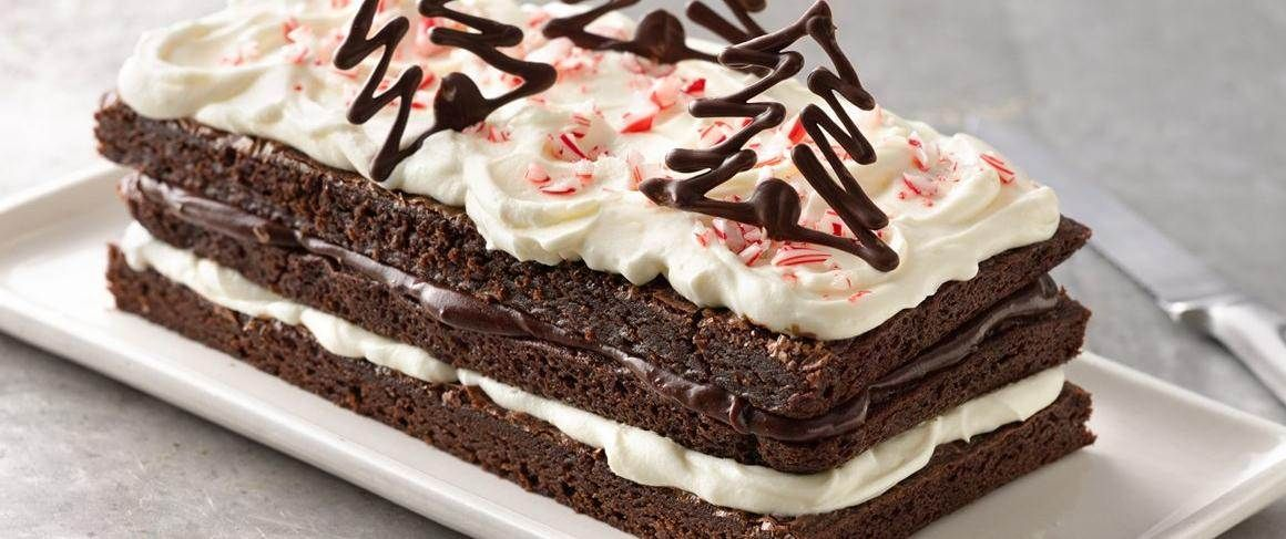 Brownies get dressed for a party with layers of peppermint cream and decadent chocolate ganache.