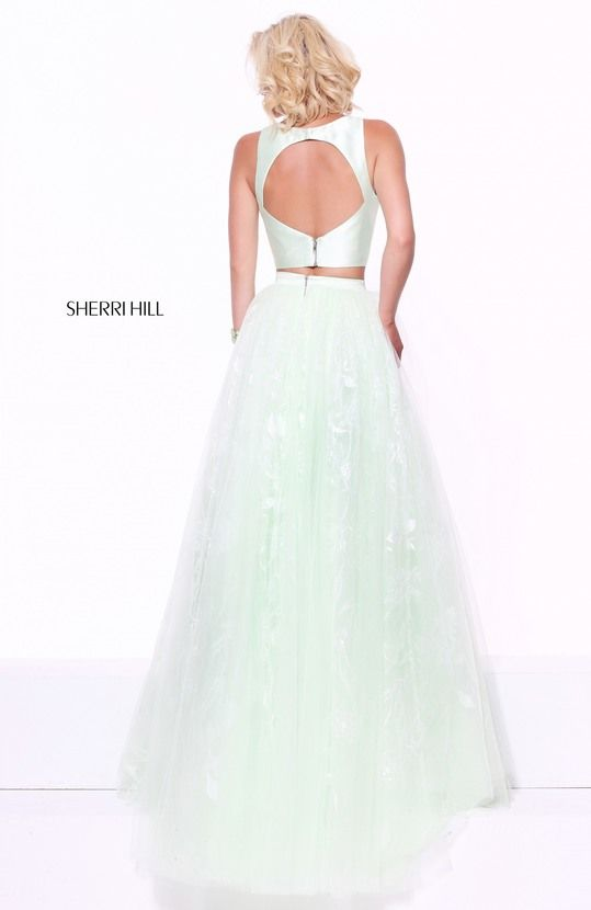 Two-piece with cut out back and a-line tulle skirt with sequin embroidery.