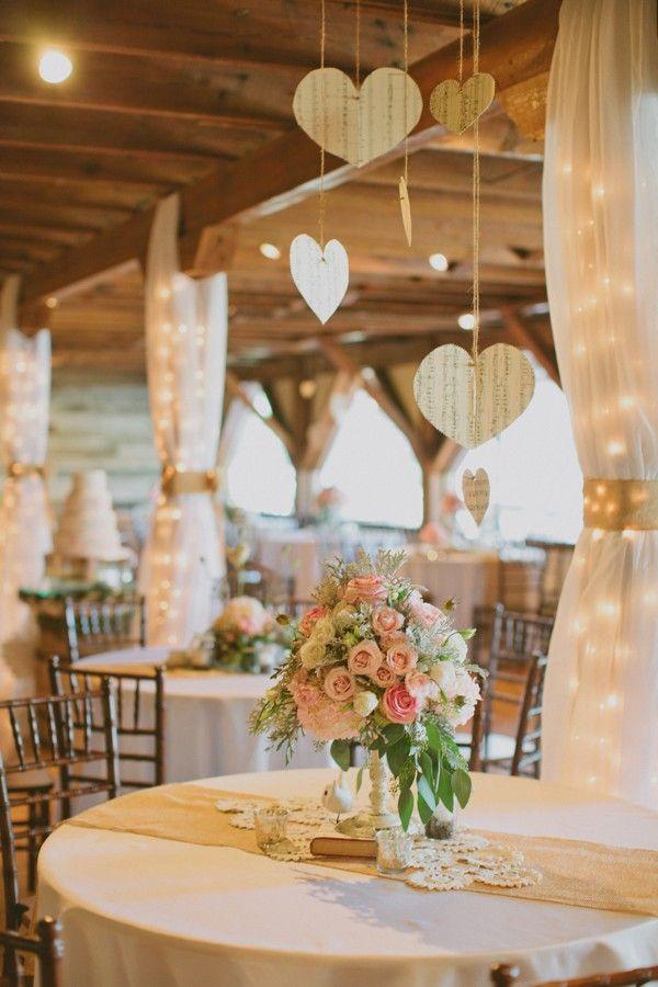 Dangling wooden hearts make this rustic wedding decor romantic