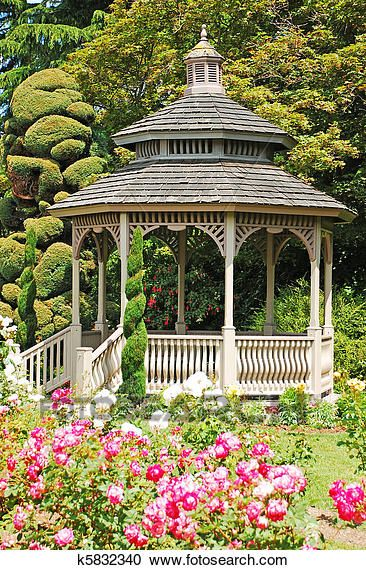 Wooden gazebo in rose garden Stock Photography is part of Rose garden Fence - Wooden gazebo in rose garden in spring