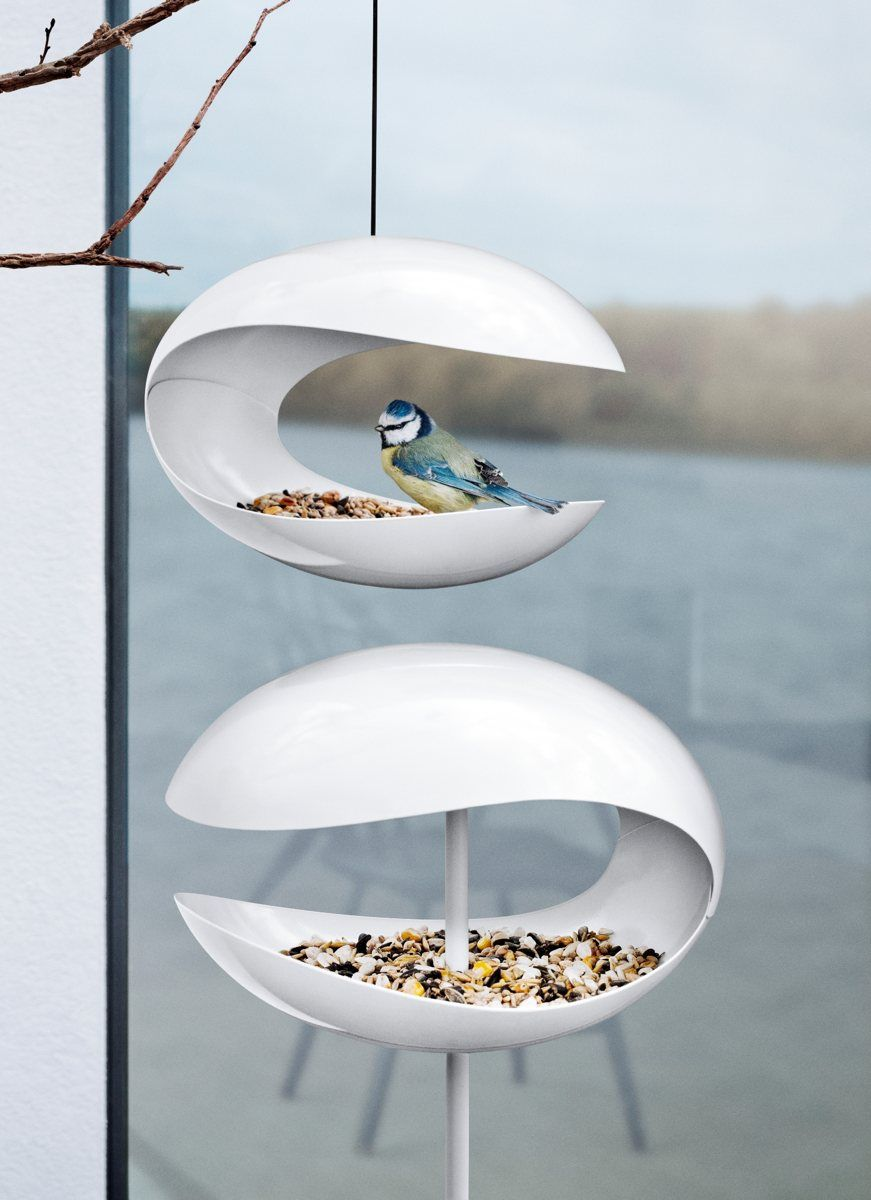Very modern, very cool bird feeder. Something for my feathered friends (feeding station!) and something for me (garden art!).