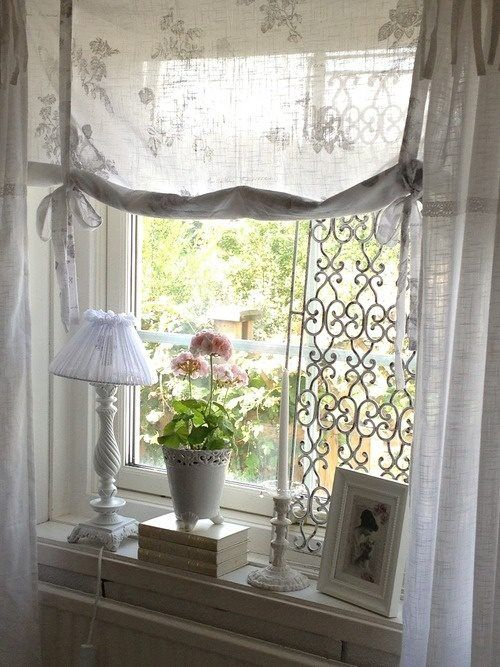 I love the roman/rolled window covering, very light and airy ~❥
