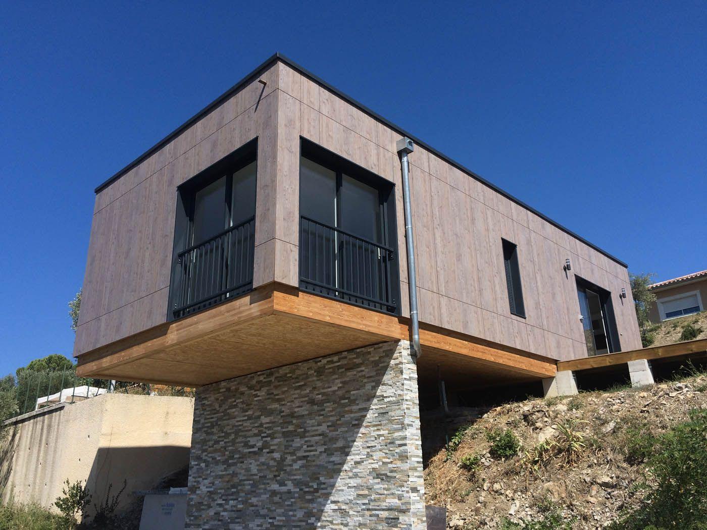 Petite maison bois en porte faux par moulin charpente for Construction petite maison