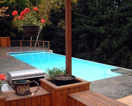 Infinity edge above ground pools inground above ground for Fiberglass pools above ground