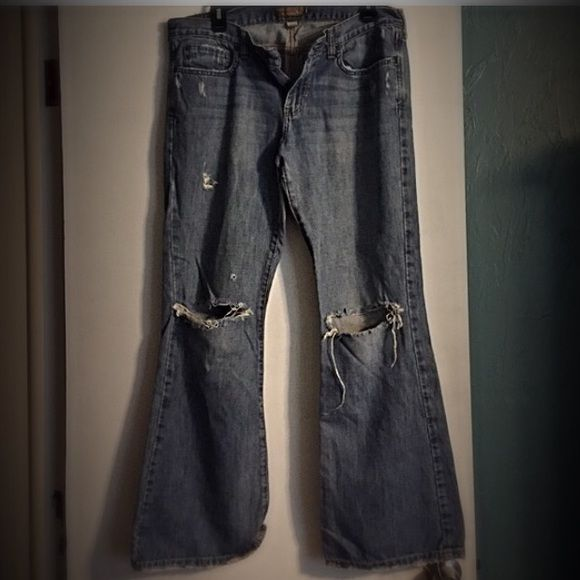 Abercrombie & Fitch jeans Abercrombie and Fitch jeans. Lots of holes (purchased this way) and tattered bottom of jeans (again purchased this way). Very cute and comfy. Size 10s. Flare. Like new! Abercrombie & Fitch Jeans Flare & Wide Leg