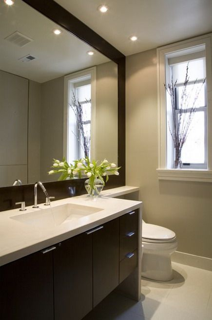 An Oversized Mirror Recessed Lighting Extended Vanity Counter To