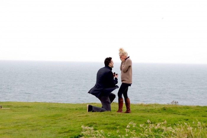 He surprised her with a trip to Scotland, but that wasn't all! He asked her to marry him in front of a castle, and it's so romantic. <3