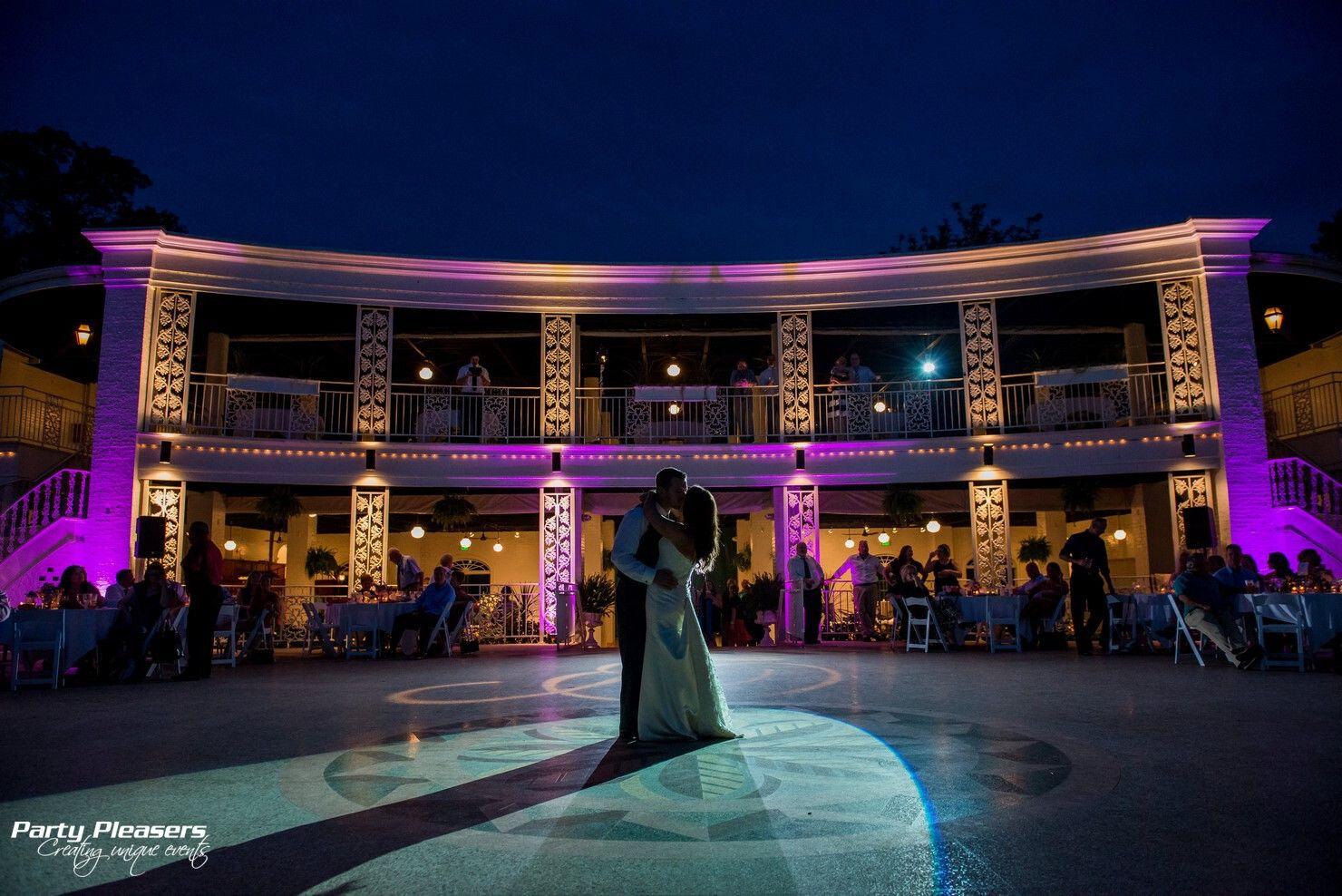 Couple shares first dance with purple uplights and intelligent light spotlight  Photo Credit- Dolce Vita  #CincinnatiWedding #PartyPleasers #Uplights #Intelligentlight
