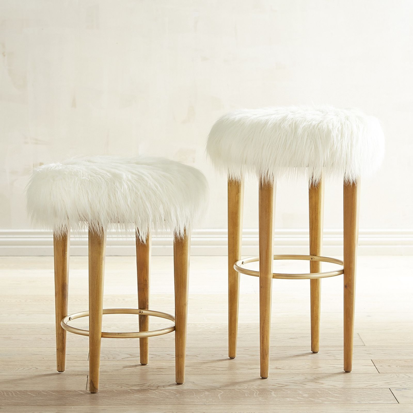 With a faux fur seat and solid birch legs our Kate stools boast