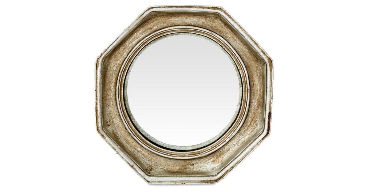 This convex mirror's octagonal frame features a shimmering silver-leaf finish with a rich, multi-tonal patina. Add it to any wall for a touch of antique allure.