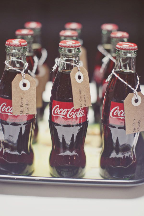 Classic Coca Cola bottles with other refreshments, or as escort cards | Black Tie Retro Wedding