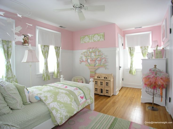 Pink and white girls bedroom with wainscoting white walls and a iron ...
