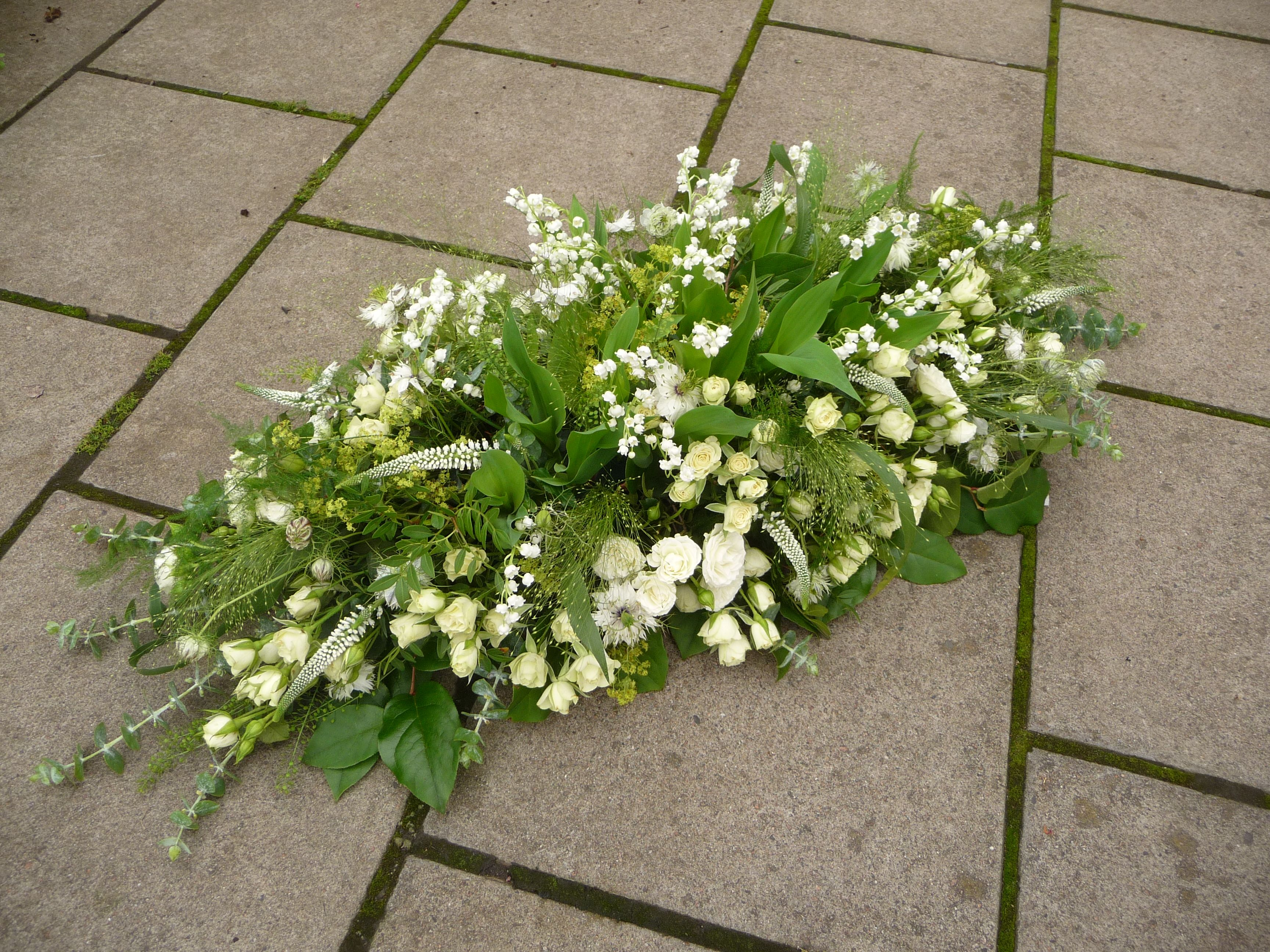 Coffin Tribute With Lily Of The Valley Veronica Roses And