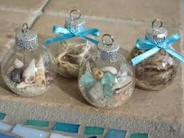 make your own stunning nautical beach inspired christmas ornaments by filling glass ornament balls with sand tiny seashells beach glass raffia - Beach Christmas Ornaments