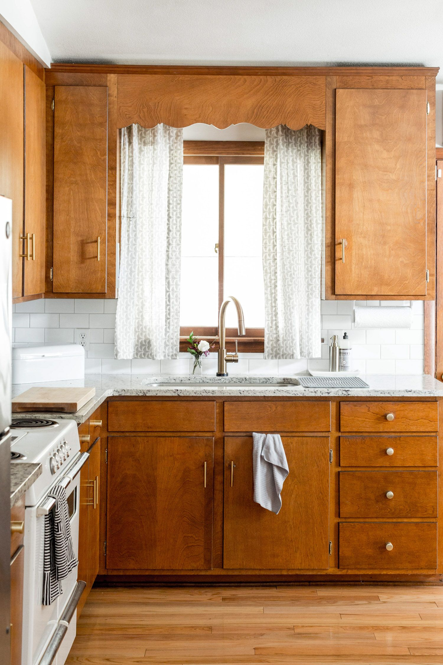 I Guess If I Couldn T Afford New Cabinets Going Mid Century Modern Wouldn T Be A Bad Way To Go Birch Kitchen Cabinets Luxury Kitchen Cabinets Cabinet Decor