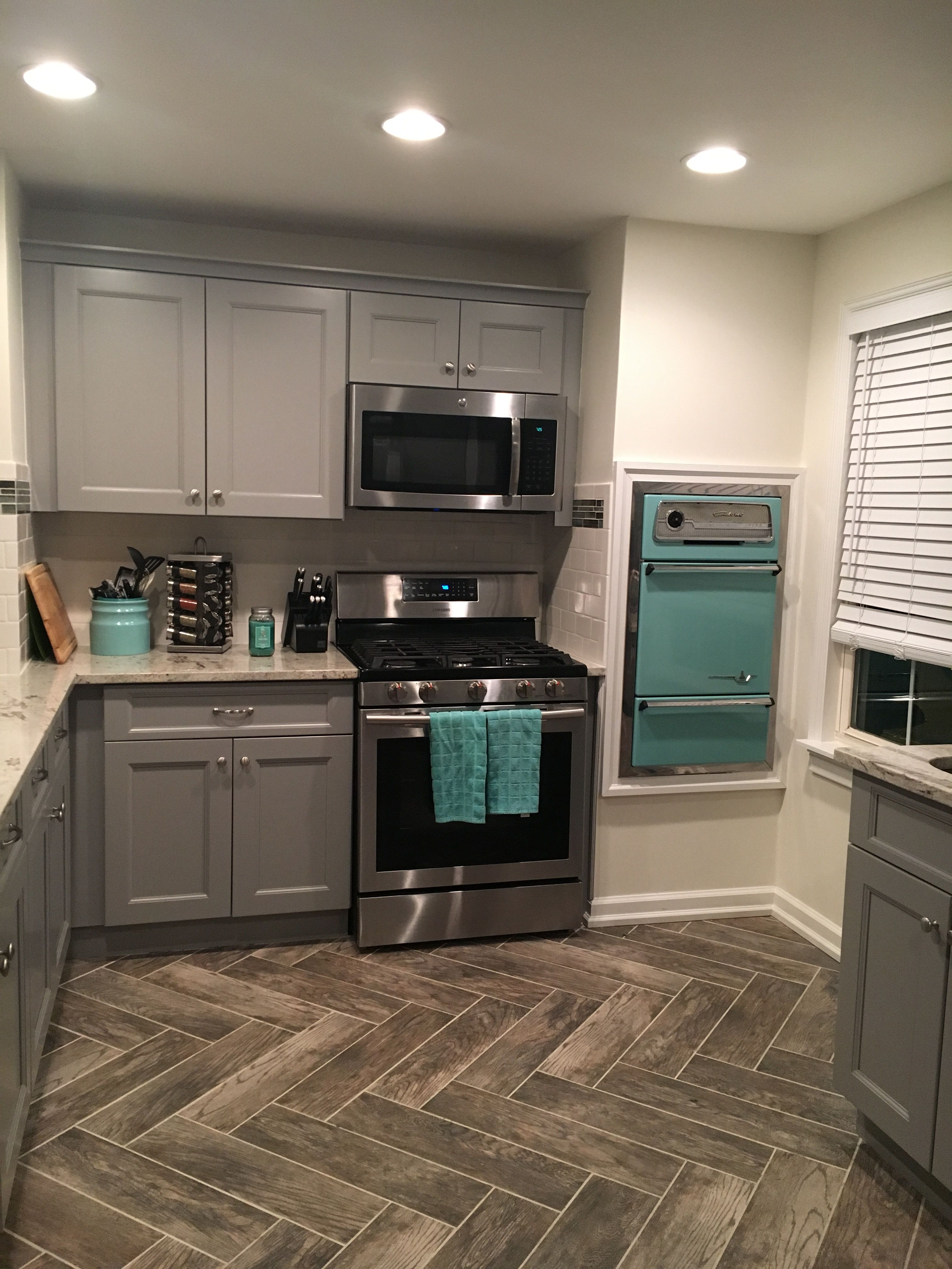 Gray Cabinets Vintage Wall Oven Teal Accents Herringbone Tile Flooring Pattern Black Kitchen Decor Modern Grey Kitchen Teal Kitchen