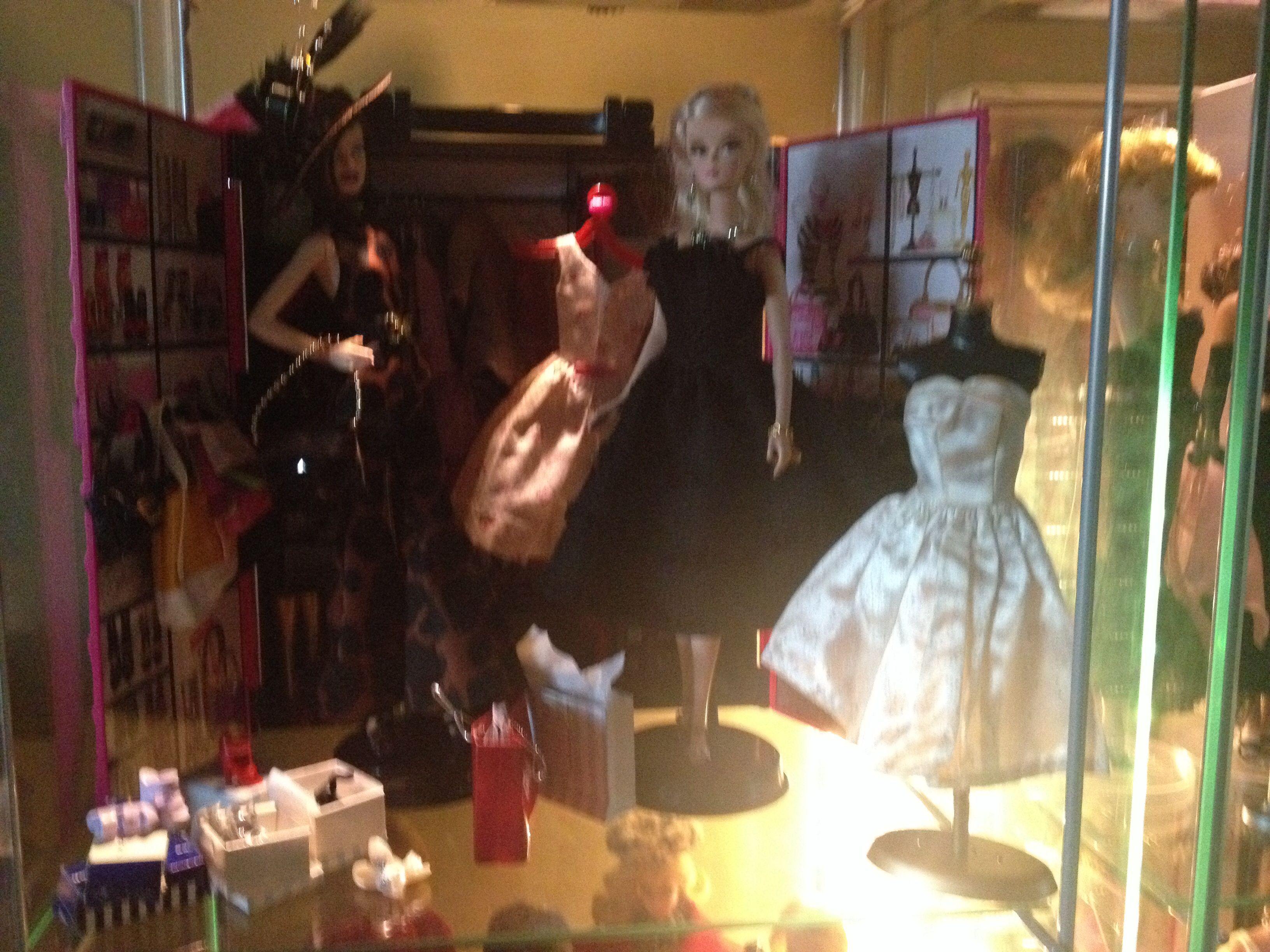 Barbies in shopping spree diorama.