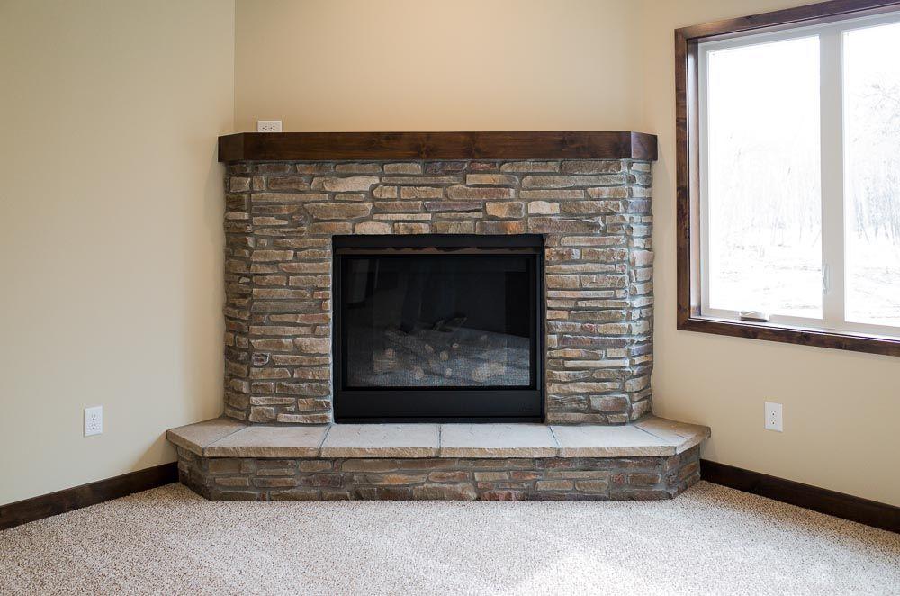 Corner Fireplace With Bucks County Ledgestone Alder Cap And Raised Stone Hearth Fireplace Tile Corner Fireplace Farmhouse Fireplace