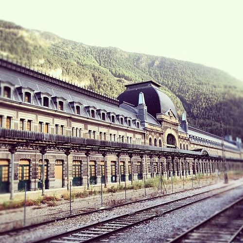 Canfranc International Railway Station (Spanish: Estación Internacional de Canfranc) is a former international railway station in the village of Canfranc in the Spanish Pyrenees, at one end of the tunnel which carried the Pau to Canfranc line under the Pyrenees. Opened in 1928, the main building is 240 metres long and has 365 windows and 156 doors.