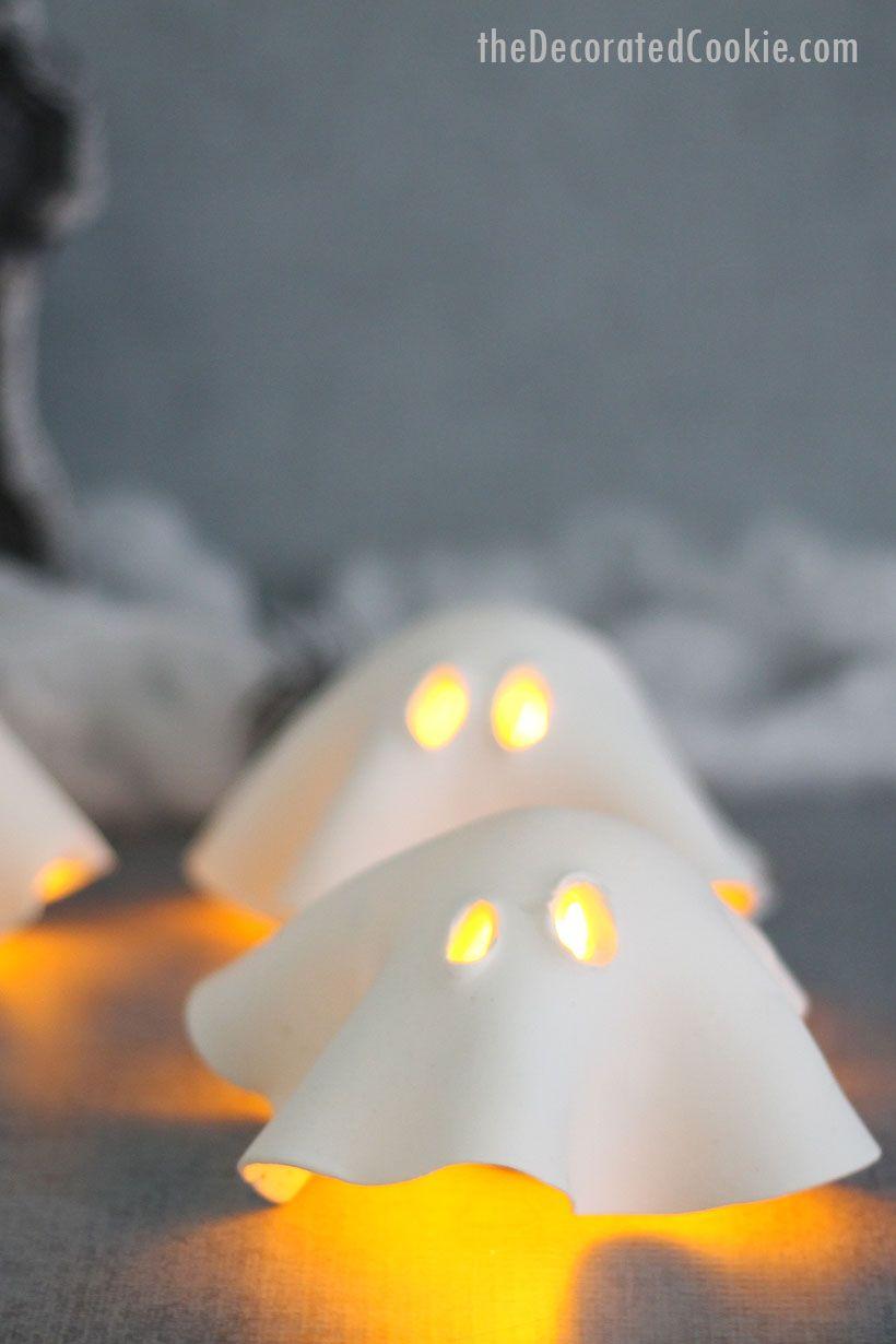 HALLOWEEN CRAFT IDEA: Easy air-dry clay ghost tea lights for a fun Halloween decor idea. Great centerpiece or mantle decor.